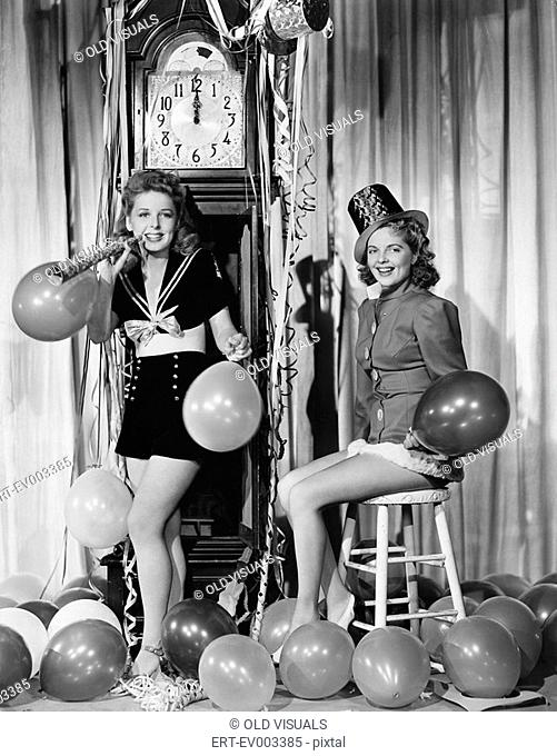 Women with balloons on New Years Eve All persons depicted are not longer living and no estate exists Supplier warranties that there will be no model release...