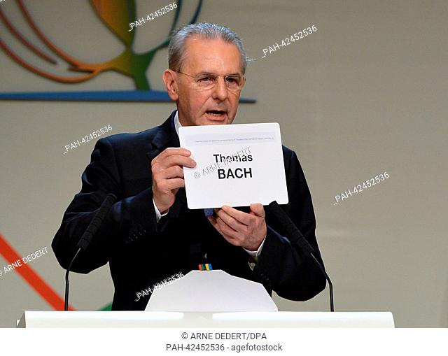 Outgoing IOC President Jacques Rogge announces Germany's Thomas Bach as new IOC President after the elction at the 125th IOC Session at the Hilton hotel in...
