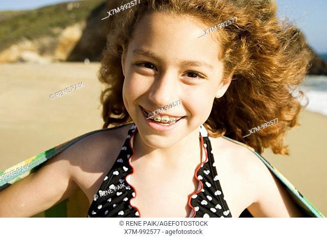 Happy young mixed race Mexican & caucasian girl at a beach in Santa Cruz, California