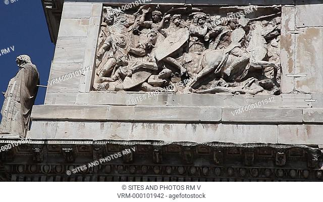 Daylight, TILT down, CU on the eastern side of the triumphal arch, situated between the Coliseum and the Palatine Hill. It was built in 315 AD and consists of...
