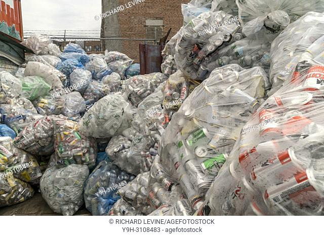Thousands of bottles and cans await pick-up from distributors at the Sure We Can non-profit redemption center in the Bushwick neighborhood of Brooklyn in New...