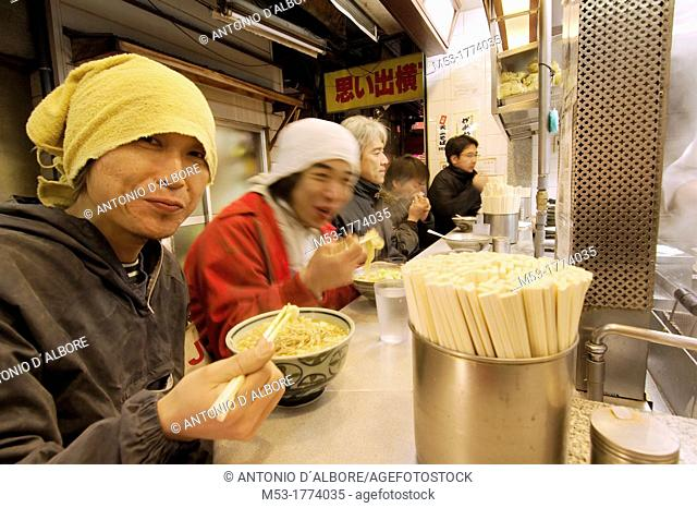japanese people enjoy ramen noodles in a traditional fast food restaurant  shinjuku district  tokyo  tokyo to  kanto region  japan