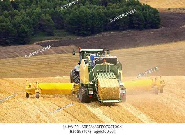 Straw baler. Agricultural machinery. Harvesting of cereals, «Learza« estate. Near Estella, Navarre, Spain