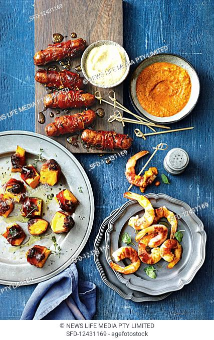 Prawns with romesco sauce; Blue cheese, pumpkin and date bites; Chipolatas with sticky mustard glaze