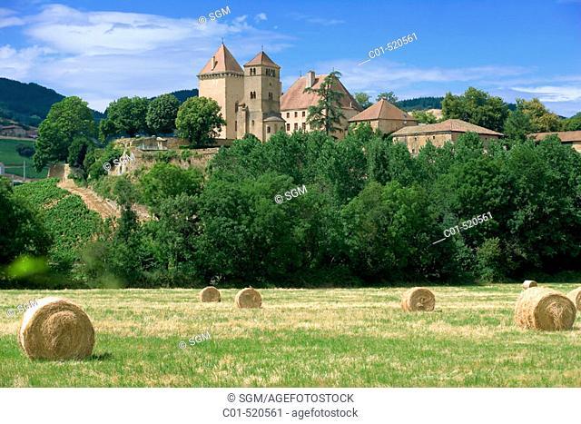 Hay bales and 'Pierreclos' castle XIVth century. Mâconnais. Wine country. Burgundy. France