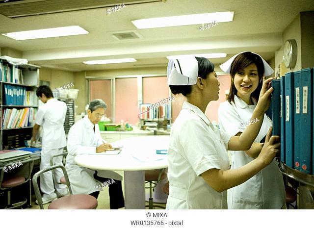 Doctor sand nurses working in nurses station