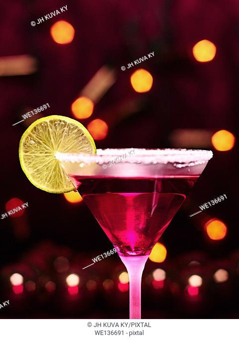 Martini glass and alcoholic beverage with a lime slice, sugar rim, girly christmas theme