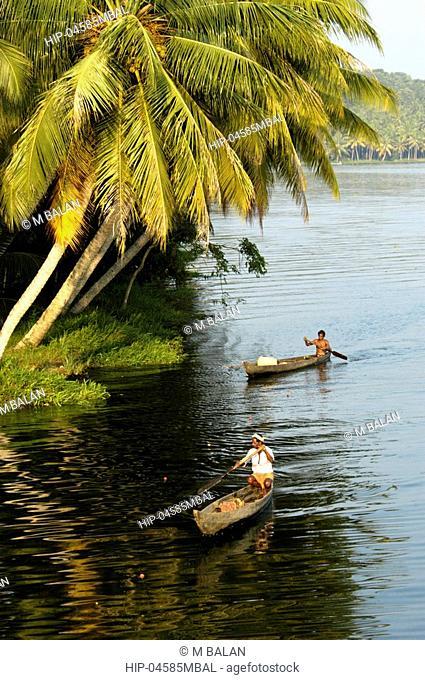 COUNTRY BOATS MOVING GENTLY ACROSS AKKULAM LAKE TRIVANDRUM