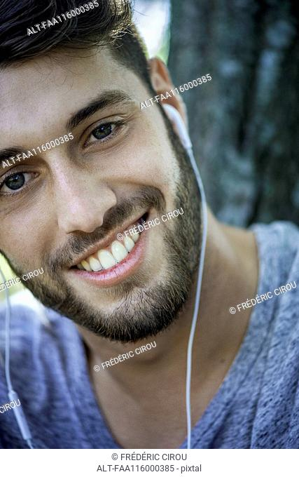 Close-up of smiling young man