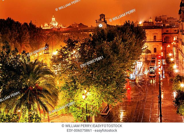 Plaza Nueva Ferdinand Statue Train Rainy Night Church El Salvador Seville Andalusia Spain