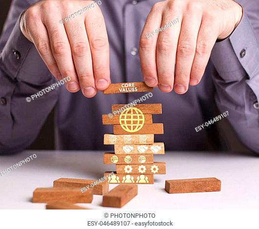 The concept of technology, the Internet and the network. Businessman shows a working model of business: Core values