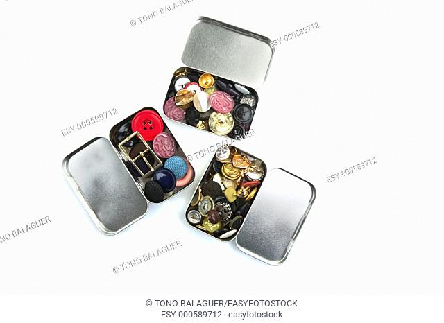 three clothing buttons metal boxes collection pattern
