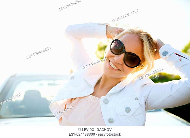 summer vacation, holidays, travel, road trip and people concept - happy smiling teenage girl or young woman near car