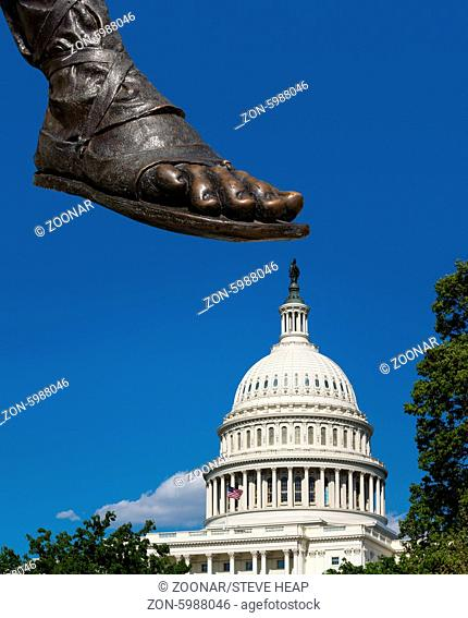 Stamp or step on Congress with composite of the foot of statue on top of the dome of the Capitol building in Washington DC showing disapproval of government