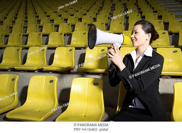 a female cheerleader holding a loudspeaker