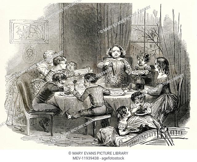 Well to do victorian family with lots of children waiting to be served their Christmas pudding