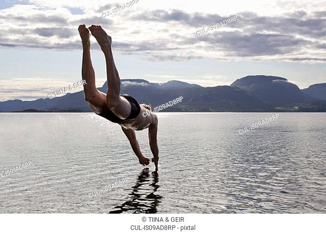 Man diving into water, Aure, Norway