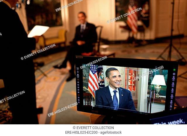 President Barack Obama tapes the weekly address in the Diplomatic Room of the White House May 29 2009., Photo by: Everett CollectionBSLOC-2011-7-245