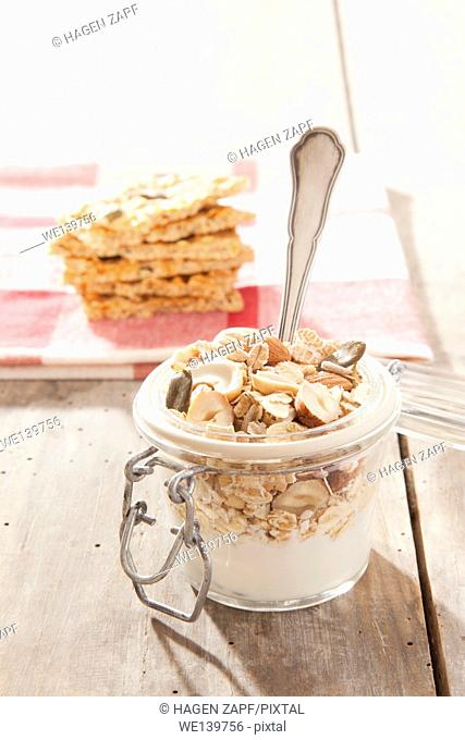 cereals with a spoon in a glass on a table