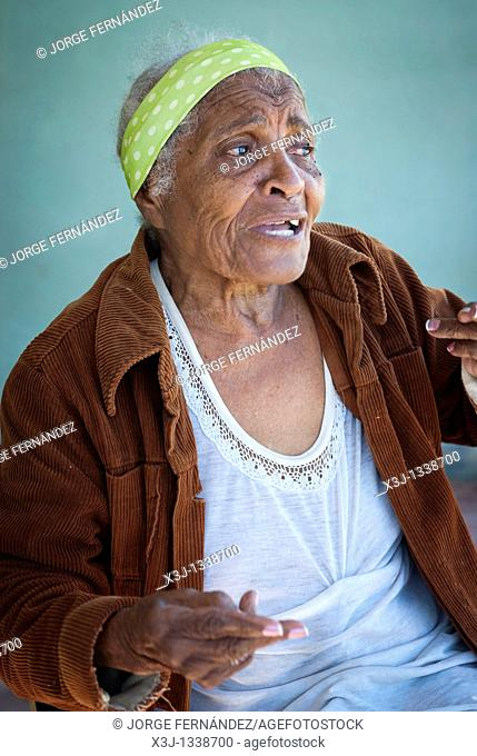 Old woman with a head band and a sad face, Palmira, Cienfuegos, Cuba, Caribbean