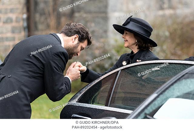 Queen Silvia of Sweden is greeted at the church where the funeral service for Prince Richard of Sayn-Wittgenstein-Berleburg will take place in Bad Berleburg