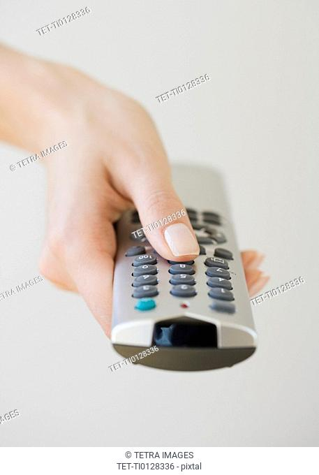 Woman pointing remote control