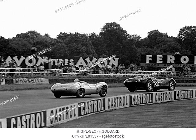 Peter Mould in a Lister Jaguar leading Alan Rees in a Lola Mk 1 into Beckett's in the sports car race. British Grand Prix, Silverstone, England 16 July 1960
