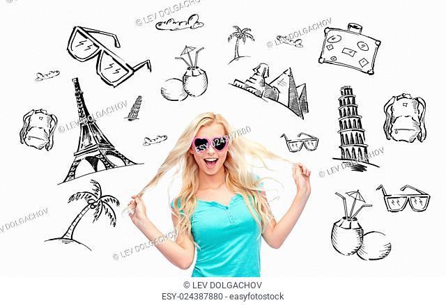 people, tourism, vacation and summer holidays concept - smiling young woman or teenage girl in sunglasses holding her strand of hair over touristic doodles