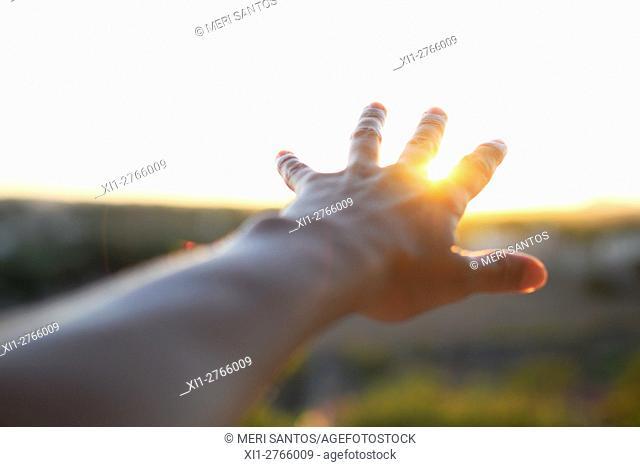 Hand reaching sun. Minorca, Balearic Islands, Spain