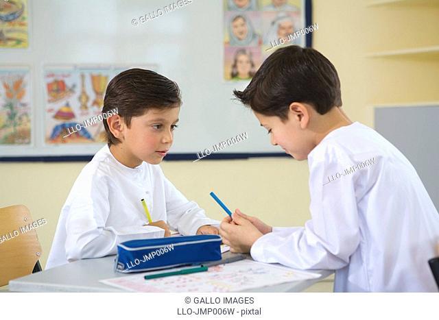 Two Young Arab Boys Working in Classroom  Dubai, United Arab Emirates