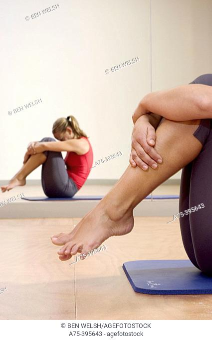 woman doing a pilates exercise