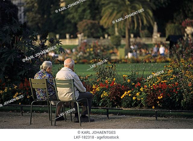 Elderly couple looking at the flowers in the Jardin du Luxembourg, largest public park in Paris, 6e Arrondissement, Paris, France