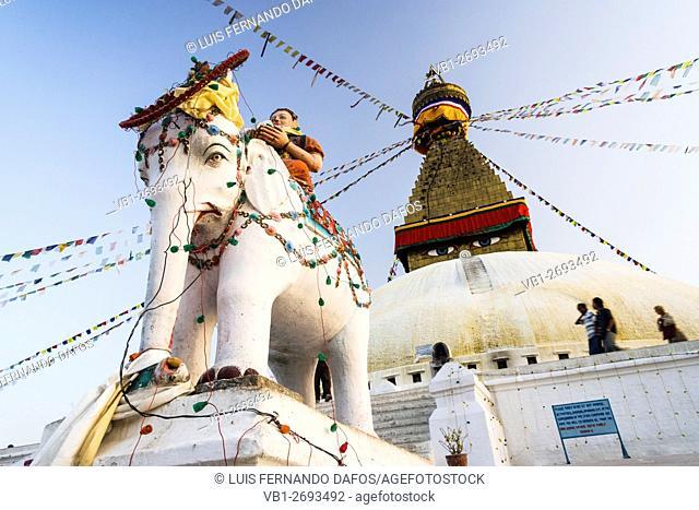 Elephant statue and Bodhnath stupa. Kathmandu, Nepal