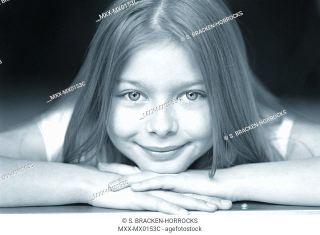 Young girl with chin resting on hands