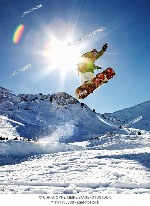 Snowboarder jumping right in
