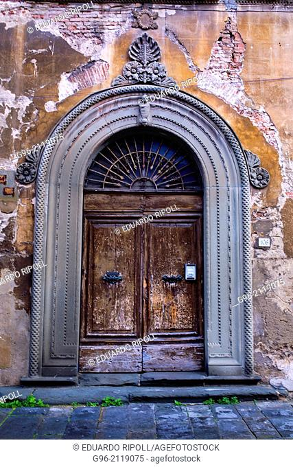 Old door in Pisa, Tuscany, Italy