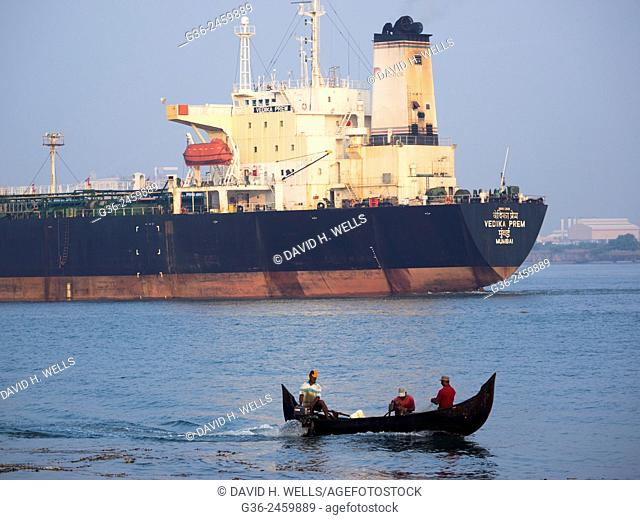 Industrial ship and fishing boat in Cochin, Kerala, India