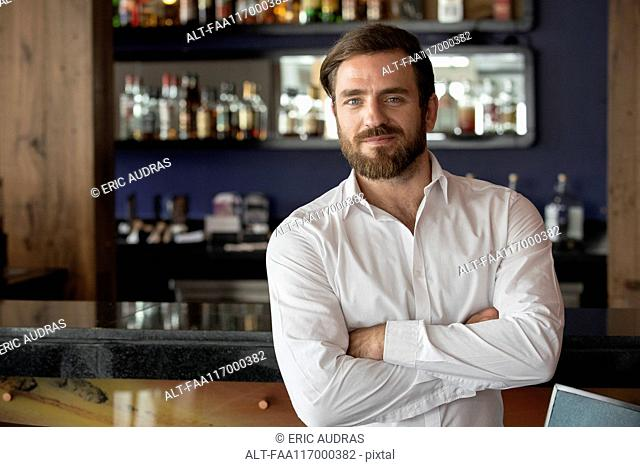Mid adult man standing in bar
