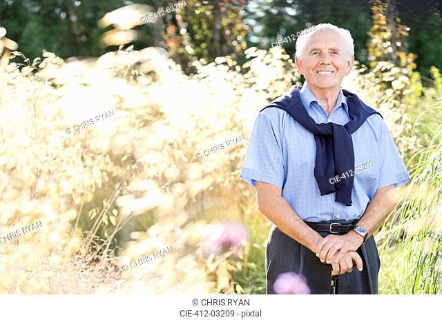 Smiling older man standing outdoors