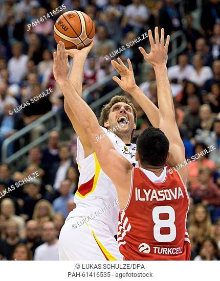 Germany's Dirk Nowitzki (l) throws the ball as Turkey's Ersan Ilyasova (r) tries to block him during the European Championship basketball game between Germany...