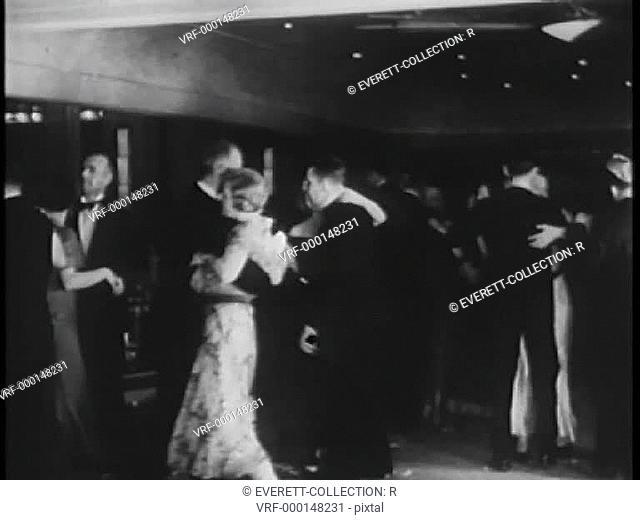 Couples dancing at nightclub