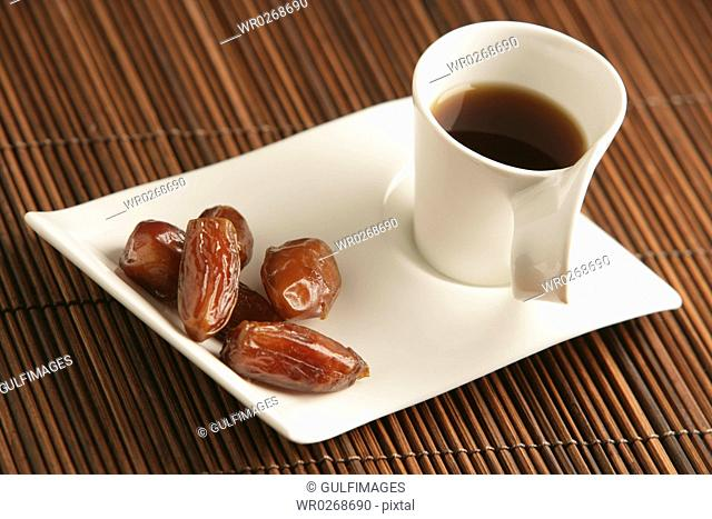 Cups of coffee and dates