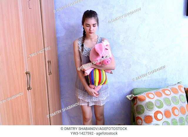 Beautiful Blond girl with her Plush Pig