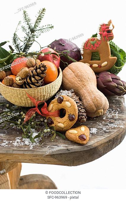 Christmas still life: fruit, vegetables, nuts & gingerbread