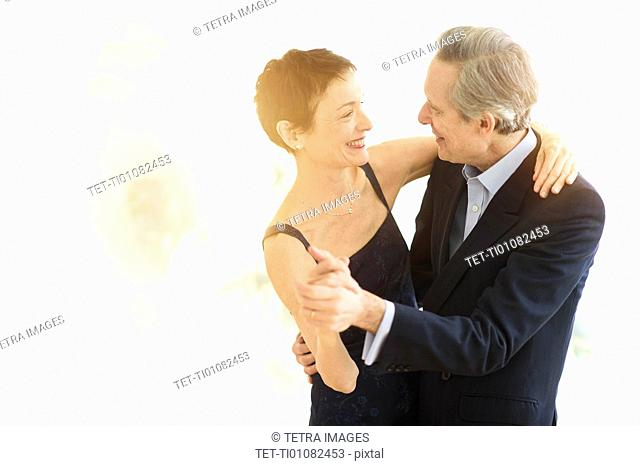 Elegant senior couple dancing while celebrating their anniversary