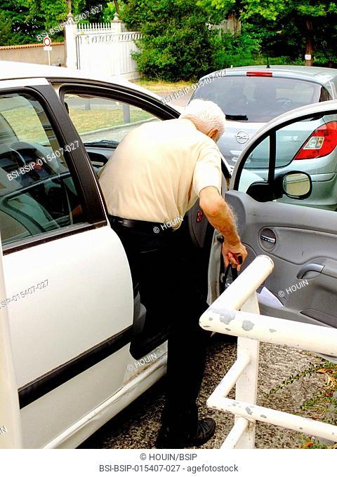 A centenarian getting into a car