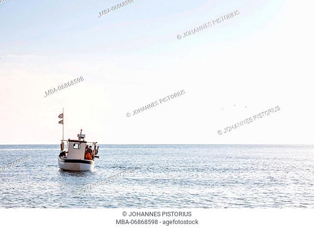 Fishing boat in front of Jons Kapel / Jon's chapel, Europe, Denmark, Bornholm
