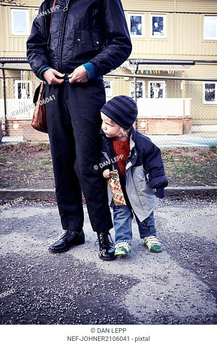 Boy standing with mother