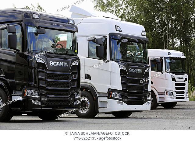 Seinäjoki, Finland - August 11, 2018. Three Next Generation Scania heavy trucks lined up on a yard, detail