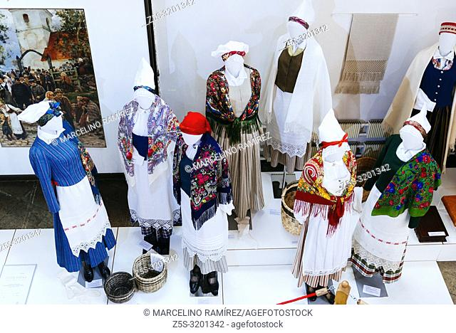"""Latvian traditional costumes. Exhibition of Arts and crafts """"""""""""""""Creative Dominance"""""""""""""""". National cultural identity. St. Peter's Church is a Lutheran church in..."""